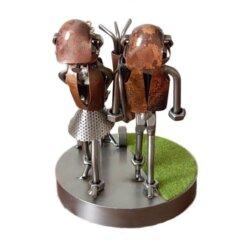 Figurine couple golfeur