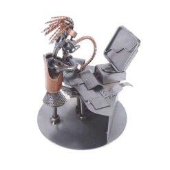 Figurine banquière en métal